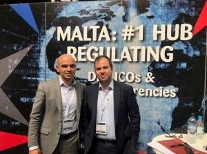 Simon Schembri and Leonard Bonello in front of Malta booth at Global Blockchain Expo in London