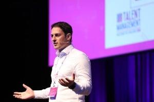 Matthew Brincat speaking on stage.